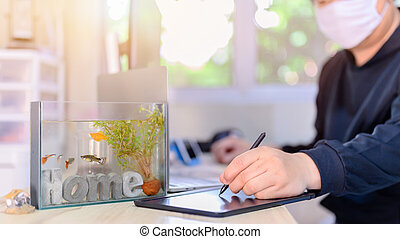 Lock down and Self-quarantine. Work home with fish in tank. Recreation during the Corona virus crisis. Stay home for relax and Social distancing.