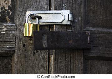 Lock key on vintage wooden door