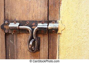 lock of the door locked with padlock.