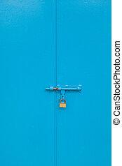 Lock on a blue metal gate