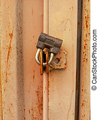 Lock on a rusty metal garage