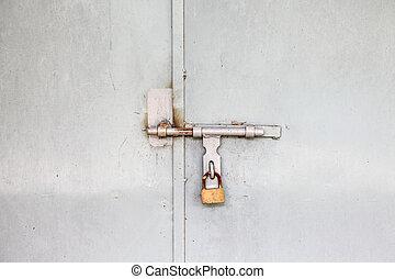 Lock on a white metal gate