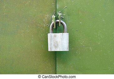 Lock on the green door.