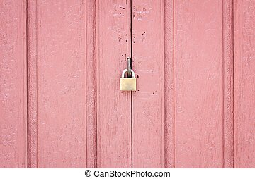 lock on the middle of pale red wood door