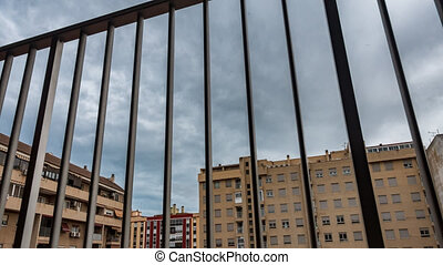 Locked behind grille under quarantine in the city, ...