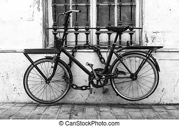 Locked bicycle in black and white