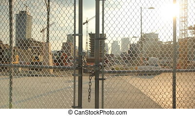 Locked gate at worksite. - Locked gate at construction...