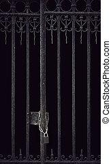Locked metal door - Door with metal bars locked with chain ...