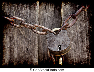 locked - old lock and chain around wooden fence
