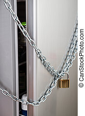 Close-up Of Refrigerator Locked With Chain And Padlock