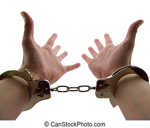 Locked Up - Photo of a mans wrists handcuffed with hands out...