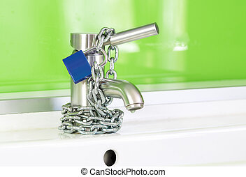 Locked Water Faucet - a waterdrop is dripping out of a ...