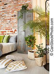 Locker and plants in bedroom