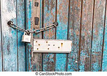 Locker on a vintage old wooden door