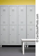Locker room - Row of steel lockers with white bench