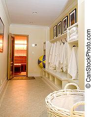 locker room with bathrobes towels