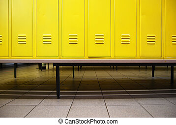 Locker room - Yellow doors in a locker room and a bench