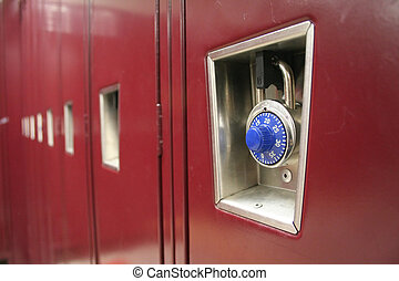 A row of lockers with the focus on the lock of the first one.