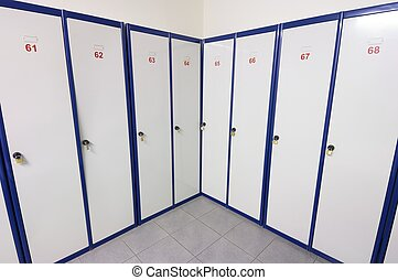 lockers numbered white and blue for clothing and personal...