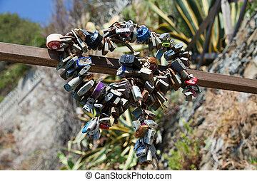 Lockers symbolizing love in Cinque Terre, Italy