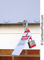 Lockout Tagout - An industrial machine power switch with...