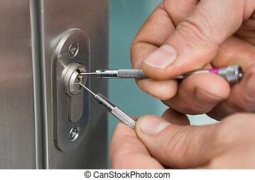 Lockpicker Fixing Door Handle At Home - Close-up Of...