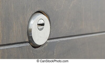 locks a door lock with a key