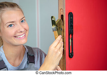 locksmith fixing a lock