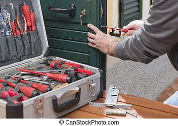 Locksmith repair the lock - Locksmith repair a door lock...