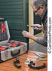 Locksmith repair the lock - Locksmith repairing a door lock...