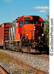Locomotive - A locomotive with wagons on a railway.