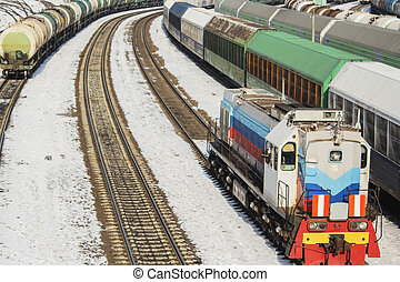 Locomotive and a lot of freight cars. in winter.