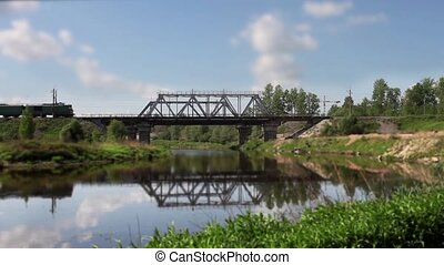 locomotive and freight train on the bridge