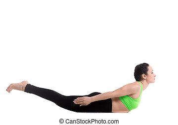 Locust yoga Pose - Beautiful slim girl doing pilates...
