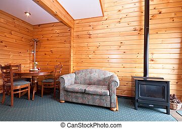 Lodge apartment interior with fireplace. Fox Glacier Lodge, ...