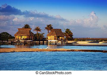 Lodges over transparent quiet sea water- tropical paradise,...
