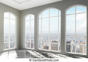 Loft interior with big windows and city view