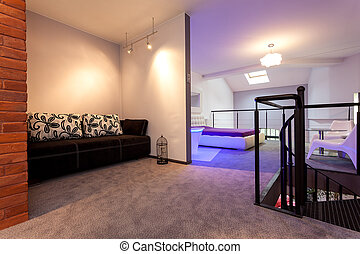 Living room, spiral staircase and bedroom in the loft