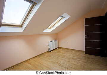 Loft Room - Interior of an empty new loft room with two roof...