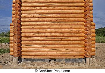 Log cabin construction - New log wooden house construction...