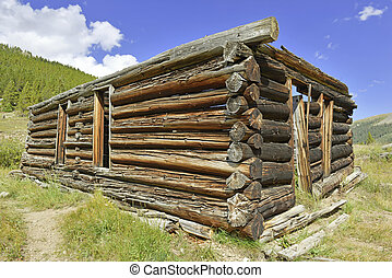 Log cabin in old mining town