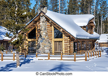 Log cabin in the winter forest of Idaho
