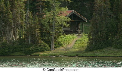 Log Cabin - Log cabin in the woods beside a lake