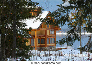 Log Cabin on the shore with snow