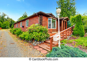 Log cabin style house exterior with curb appeal. Wooden...
