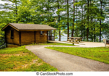 Log cabin surrounded by the forest at lake santeetlah north ...