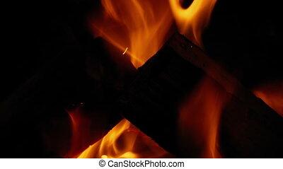 Log Fire Burns At Night Closeup - Closeup shot of log fire...