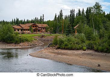 Log Home along the river in Alaska near Fairbanks