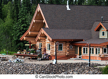 Log Home on a river shore in Alaska