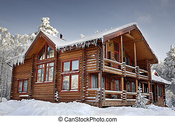 Log home winter with large windows, balcony and porch,...